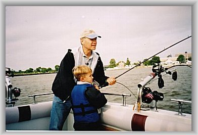 """Outdoor Wisconsin's"" Dan Small assisting a young angler"